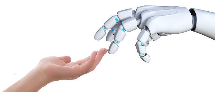 人とロボットが手を取り合うイメージ